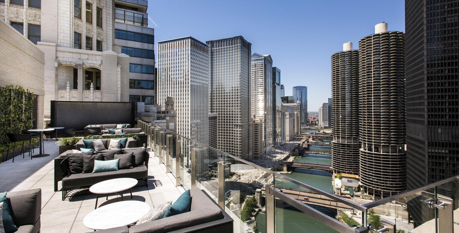 Daytime exterior view of LondonHouse Chicago and the Chicago River.