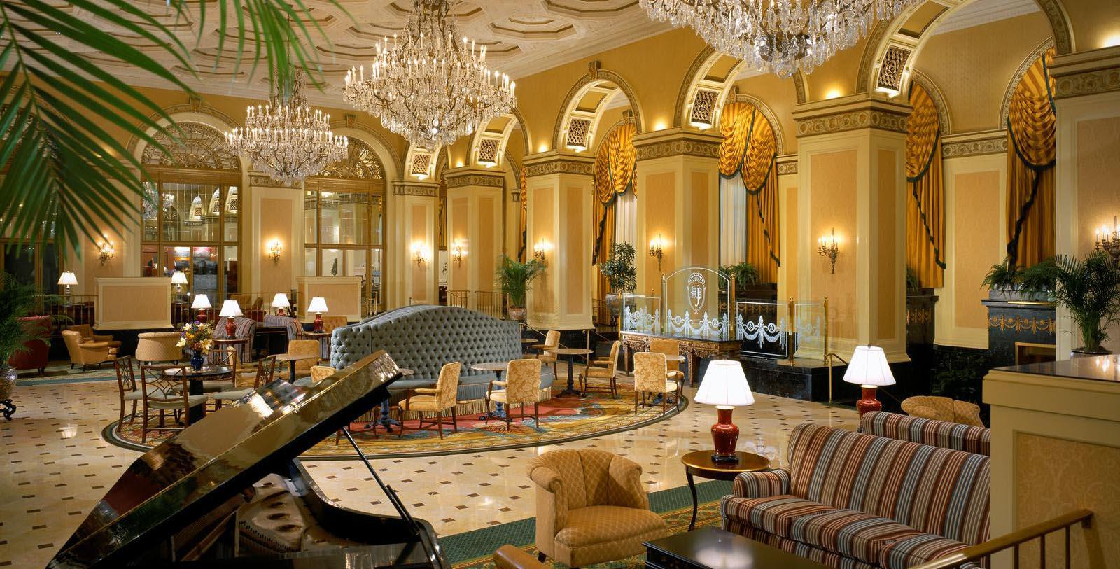Image of lobby with chandeliers and piano at the Omni William Penn Hotel, Pittsburgh, Pennsylvania.