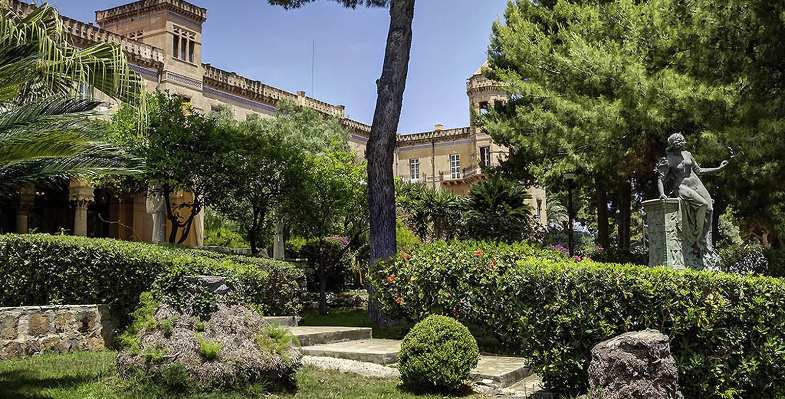 Daytime gardens and exterior of Grand Hotel Villa Igiea Palermo - MGallery by Sofitel in Palermo, Italy.