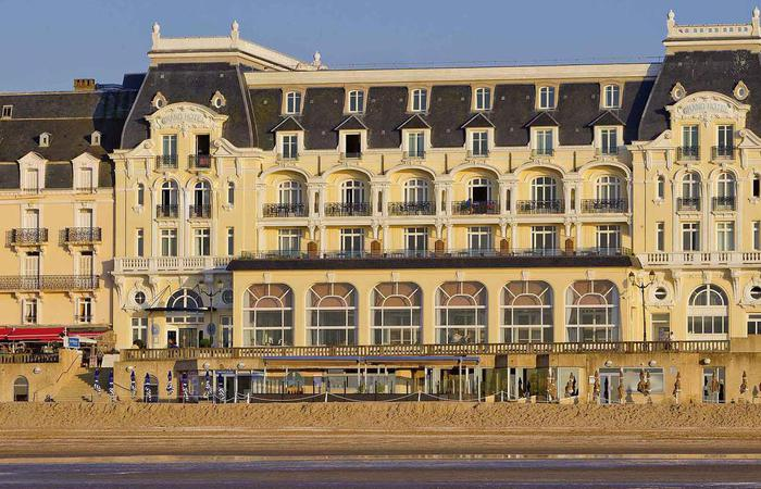 Image of beach and exterior of Le Grand Hôtel Cabourg - MGallery by Sofitel in France.