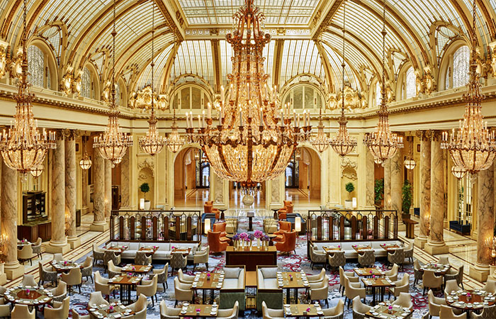 The Garden Court is crowned by a glass dome atrium and Austrian crystal chandeliers at the Palace Hotel in San Francisco.