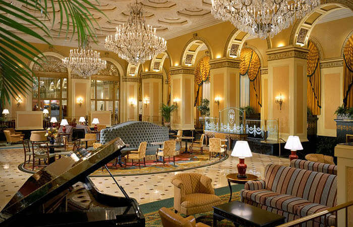 Interior lobby with chandeliers and piano of the Omni William Penn Hotel, Pittsburgh, Pennsylvania.