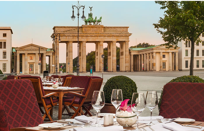 Daytime exterior patio seating at Hotel Adlon Kempinski in Berlin, Germany.