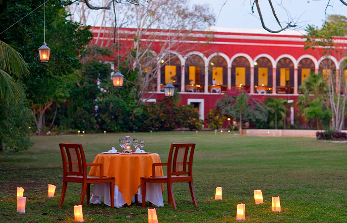 Dusk romantic dinner setting for two at Hacienda Temozon, A Luxury Collection Hotel in Yucatan, Mexico.
