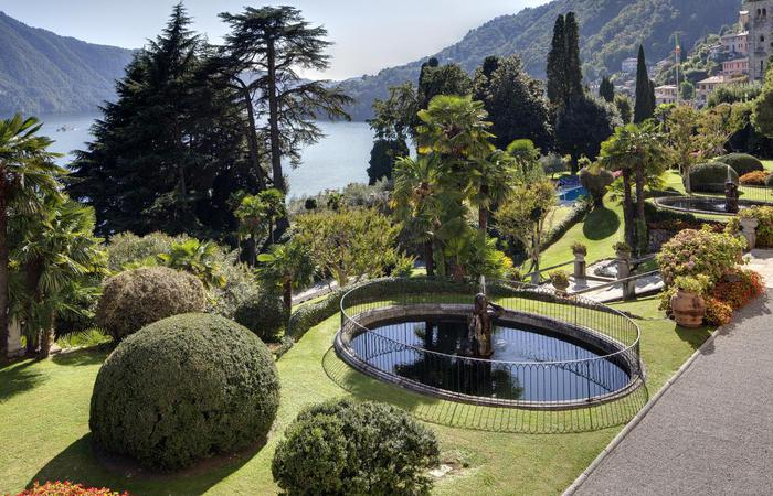 Formal lush gardens at Grand Hotel Tremezzo in Lake Como, Italy.