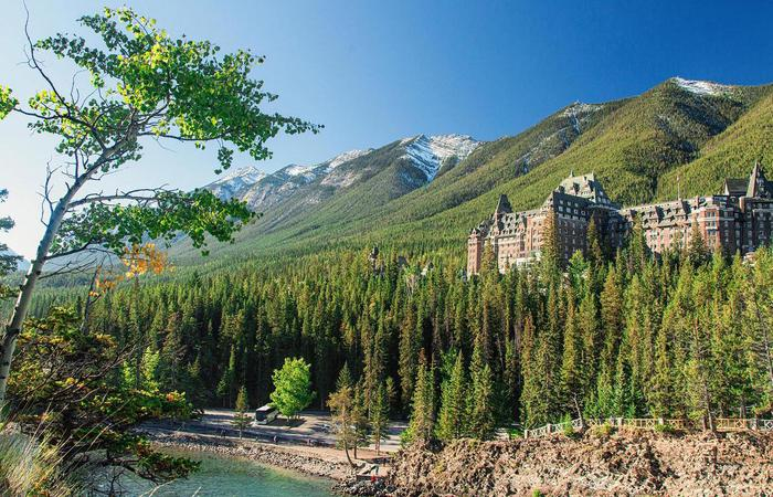 Daytime exterior of grounds and hotel of Fairmont Banff Springs in Alberta, Canada.