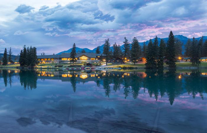 Dusk exterior of the Fairmont Jasper Park Lodge in Alberta, Canada.