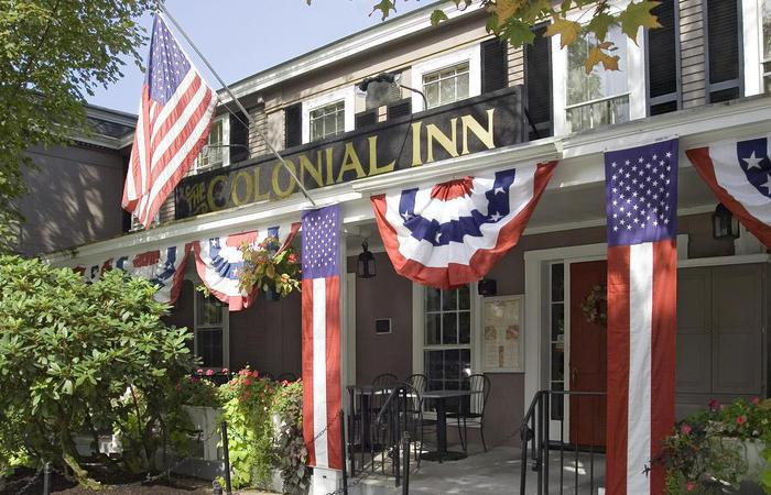 Exterior daytime of Concord's Colonial Inn in Massachusetts with patriotic bunting.