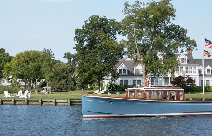 Daytime exterior of boat and the Inn at Perry Cabin in St. Michaels, Maryland.