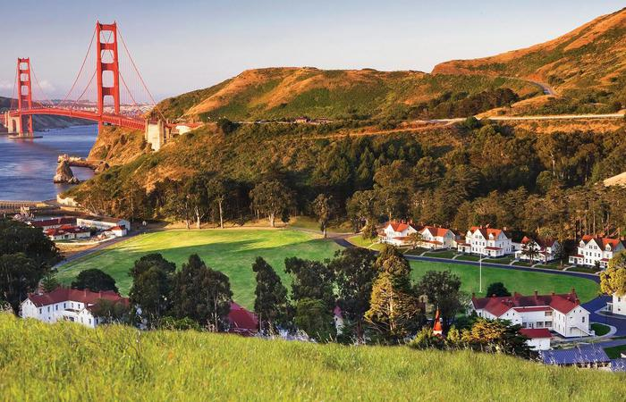 Daytime aerial view of Cavallo Point in San Francisco, California with Golden Gate Bridge in the back.