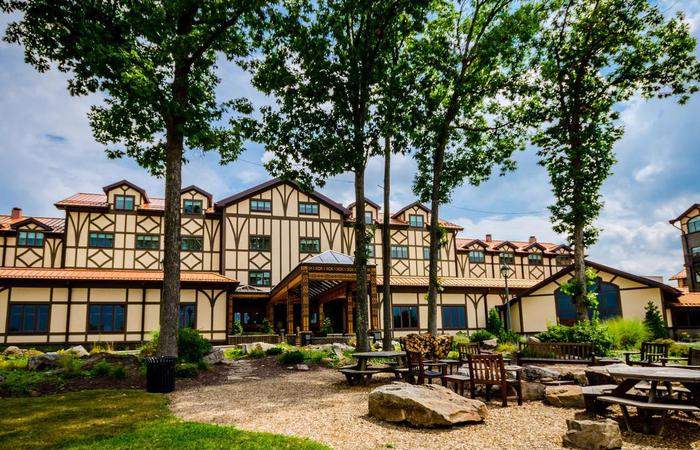 Daytime exterior of The Lodge at Nemacolin Woodlands Resort in Farmington, Pennsylvania.