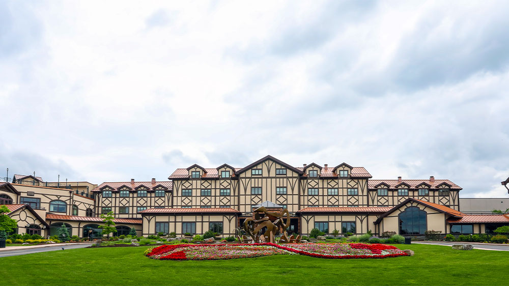 Daytime exterior of The Lodge at Nemacolin Woodlands Resort in Farmington, Pennsylvania.Daytime exterior of The Lodge at Nemacolin Woodlands Resort in Farmington, Pennsylvania.