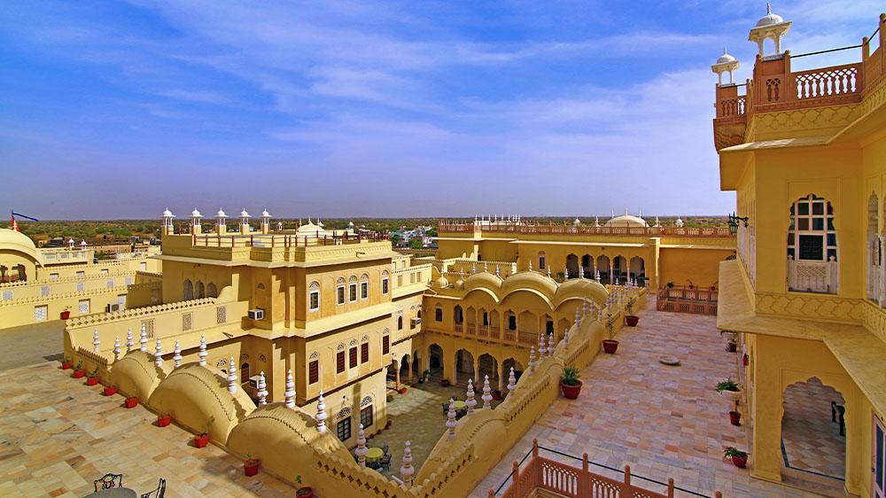 Daytime exterior of Alsisar Mahal in Rajasthan, India.