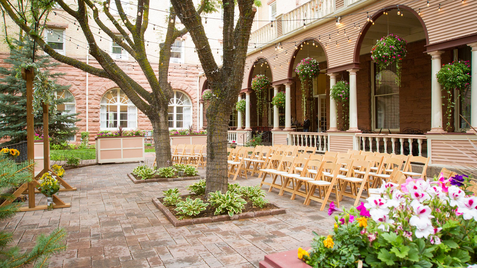 Image of Courtyard Wedding Aisle Hotel Colorado, 1893, Member of Historic Hotels of America, Glenwood Springs, Colorado