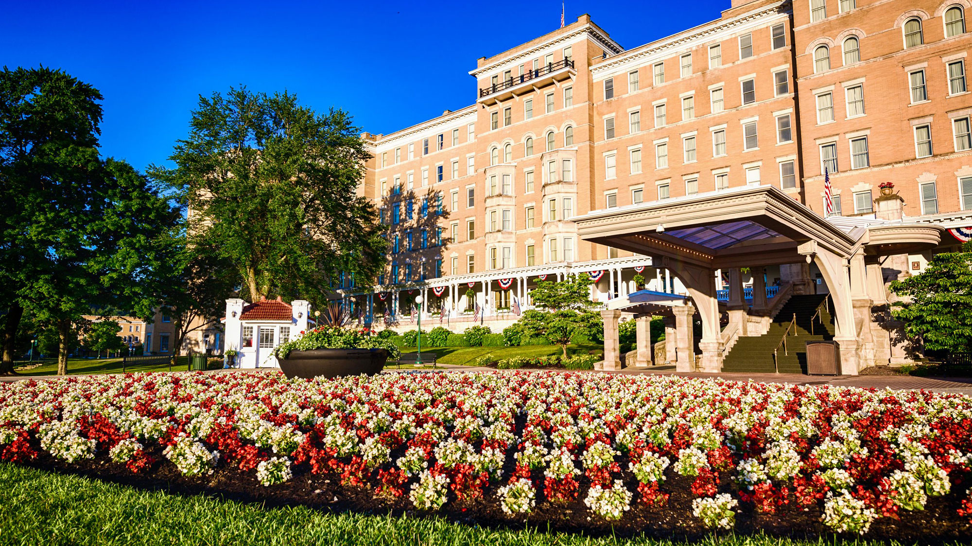 Daytime exterior with flowers at the French Lick Springs Hotel in Indiana.